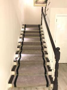 Hand Tufted Stair Carpet with Border in Meadows, Dubai
